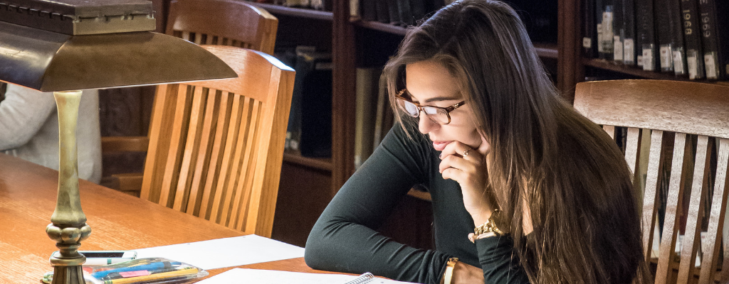 Photo of student studying at Linderman Library