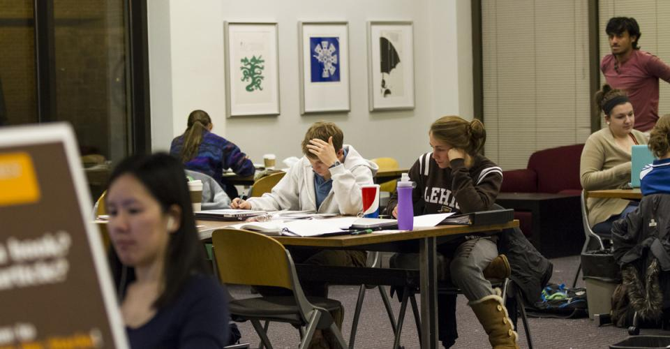 Students studying during finals in EWFM Library