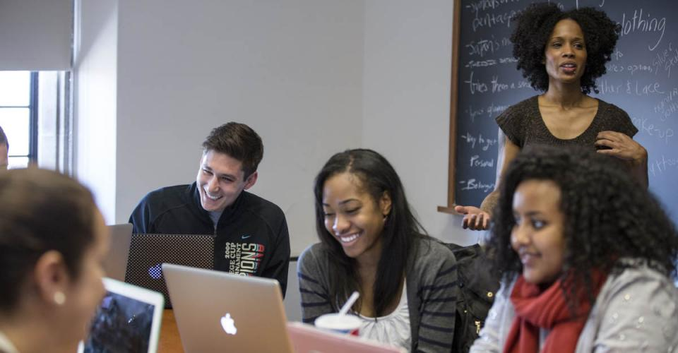 Instructor with students in front of blackboard